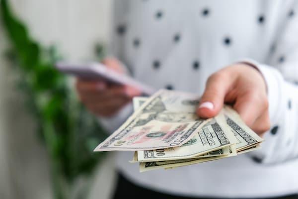 Woman handing over money.